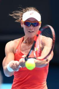 MELBOURNE, AUSTRALIA - JANUARY 20: Samantha Stosur of Australia plays a backhand in her first round match against Monica Niculescu of Romania during day two of the 2015 Australian Open at Melbourne Park on January 20, 2015 in Melbourne, Australia. (Photo by Cameron Spencer/Getty Images)