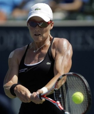 Samantha Stosur, of Australia, returns the ball to Sorana Cirstea, of Romania, during a semifinal match at Los Angeles Women's Tennis Championships in Carson, Calif., Saturday, Aug. 8, 2009. Stosur won 6-3, 6-2. (AP Photo/Jae C. Hong)